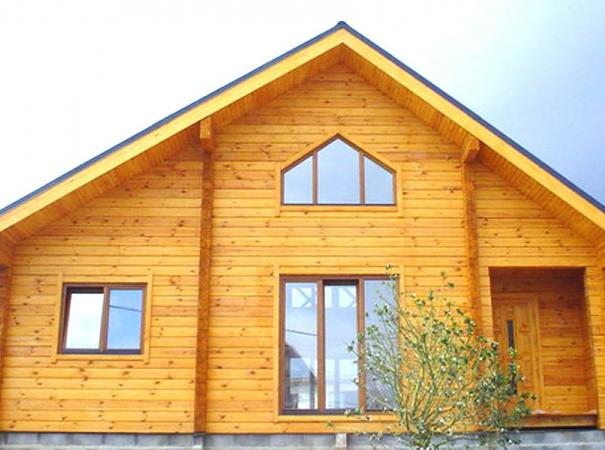 log house with windows made of wood and the input group